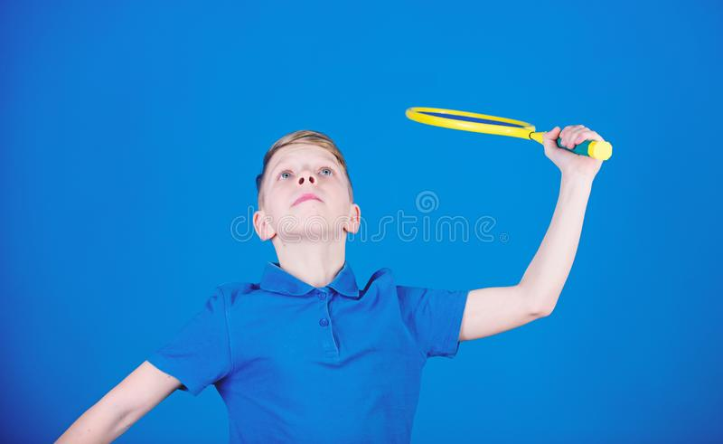 Badminton. Tennis player with racket. Badminton activity. Badminton workout of teen boy. Sport game success. Little boy. Fitness diet brings health and energy royalty free stock photo