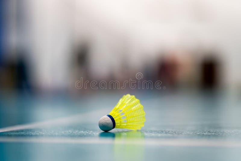 Badminton yellow  shuttlecock. Badminton yellow shuttlecock  on the green floor stock photo