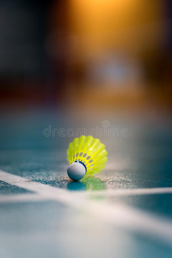 Badminton yellow  shuttlecock. Badminton yellow shuttlecock  on the green floor stock photography