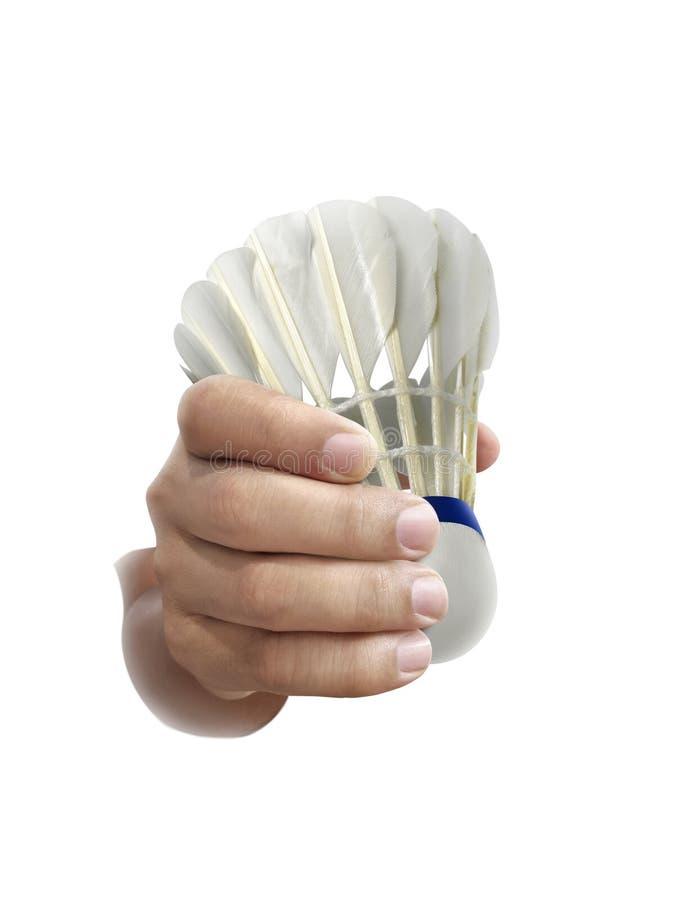Badmintonbal of shuttle op hand op een witte achtergrond wordt geïsoleerd die stock foto's