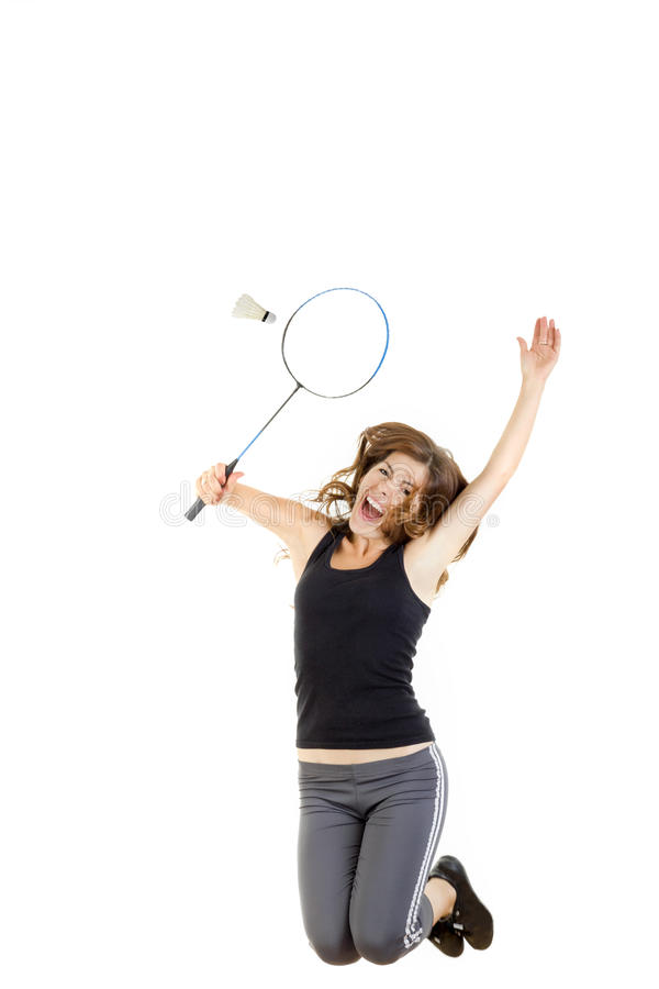 Badmintonspieler in der Aktion, die Schläger hält, um Federball zu fangen stockfoto
