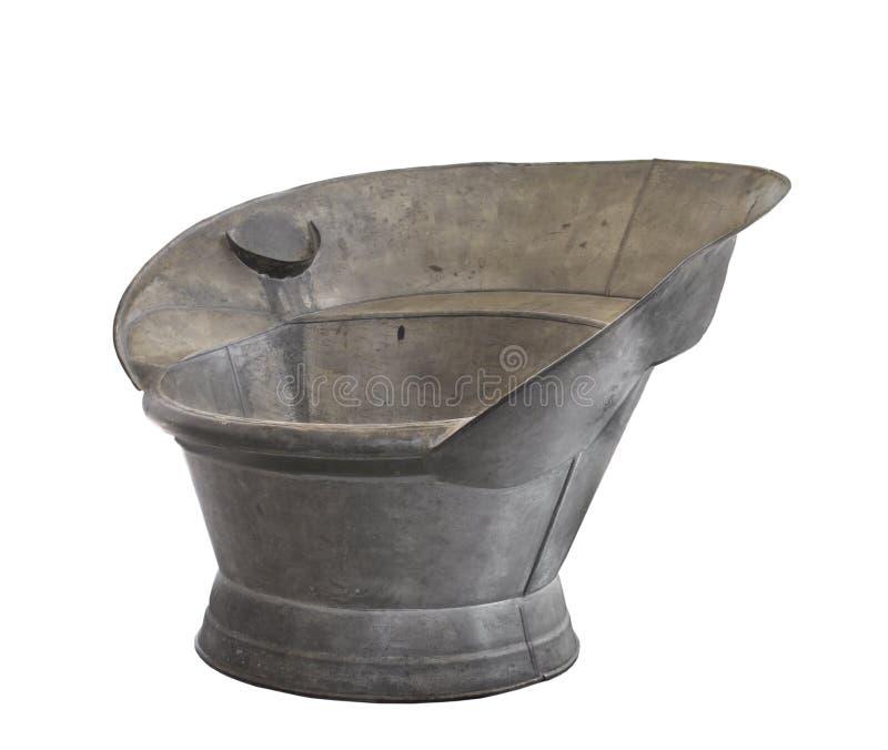 badningen galvaniserade isolerade gammala sitter tin badar arkivbilder