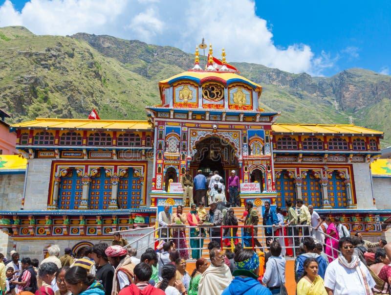 Badrinath Temple, Uttarakhand, India. BADRINATH, UTTARAKHAND, INDIA - CIRCA MAY 2013: Hindu pilgrims ascend the steps to the temple of Badri-Narayana in the stock photography