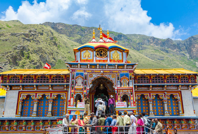 Badrinath Temple, Uttarakhand, India. BADRINATH, UTTARAKHAND, INDIA - CIRCA MAY 2013: Hindu pilgrims ascend the steps to the temple of Badri-Narayana in the royalty free stock images