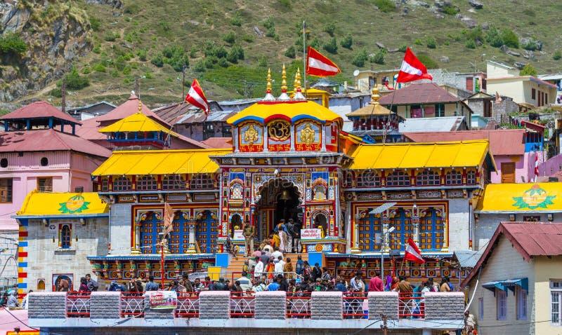 Badrinath Temple, Uttarakhand, India. BADRINATH, UTTARAKHAND, INDIA - CIRCA MAY 2013: Hindu pilgrims ascend the steps to the temple of Badri-Narayana in the royalty free stock photo