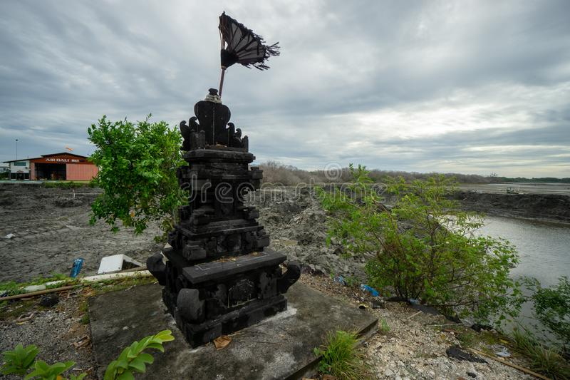 BADUNG,BALI/INDONESIA-MARCH 08 2019:Black natural stone statue for offering place royalty free stock photos