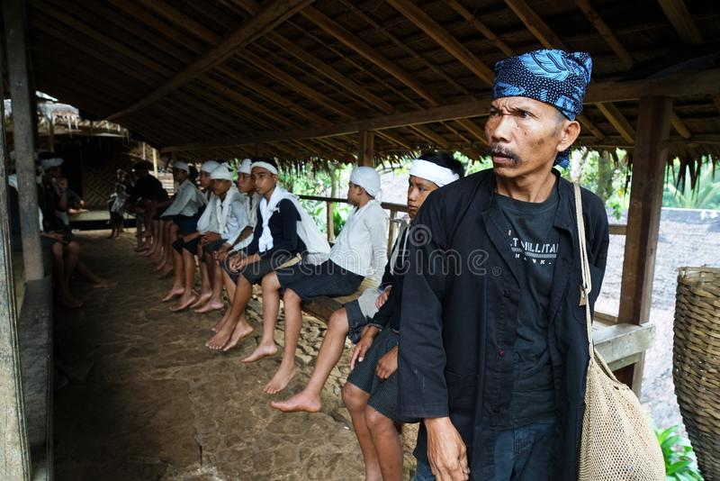 Baduy people do their activities in Kanekes village, Banten, Indonesia. Lebak Banten, West Java Indonesia - April 24, 2018 : Baduy people do their activities in royalty free stock image