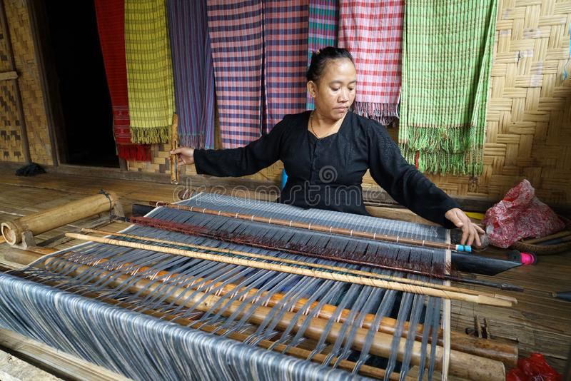 Baduy women weaving traditional cloth stock images