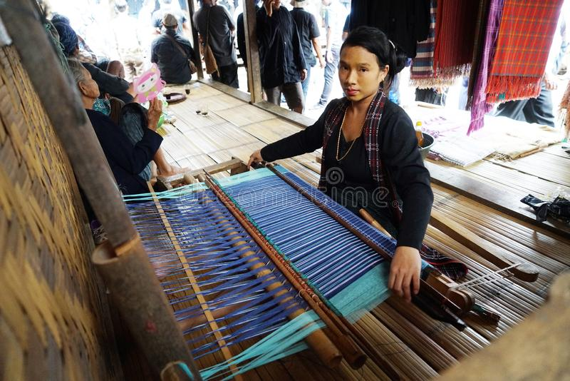 Baduy women weaving traditional cloth royalty free stock photo