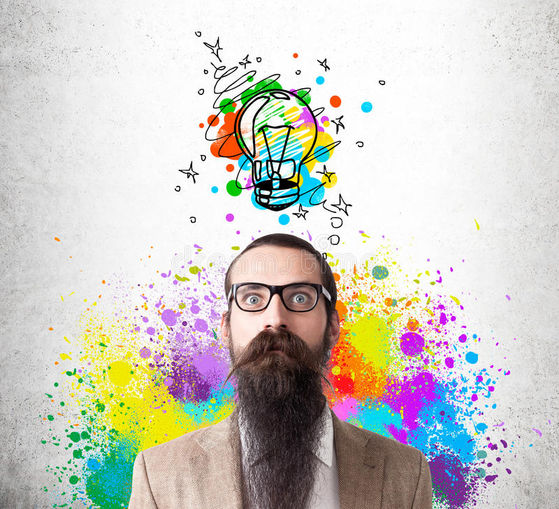 Baffled man in rainbow with colorful light bulb stock photo