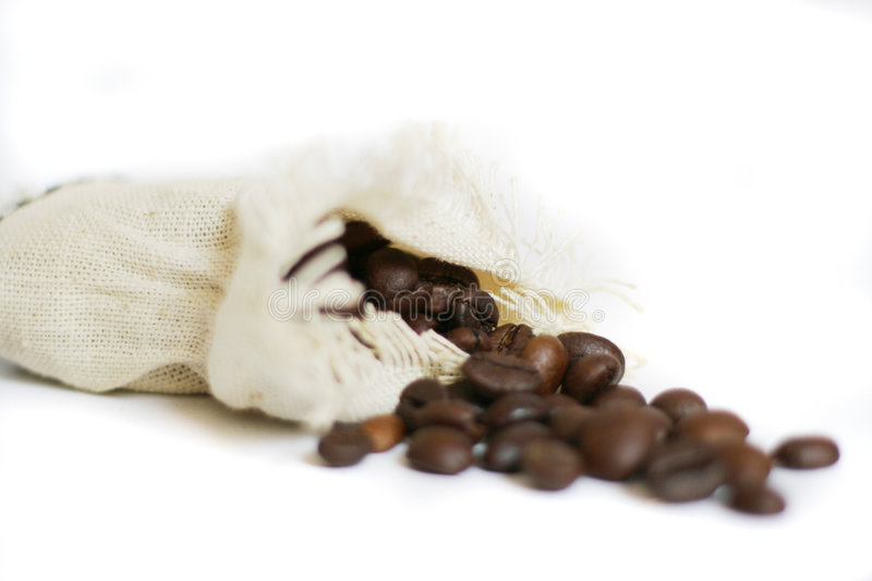 Bag with coffee beans spilled stock photography