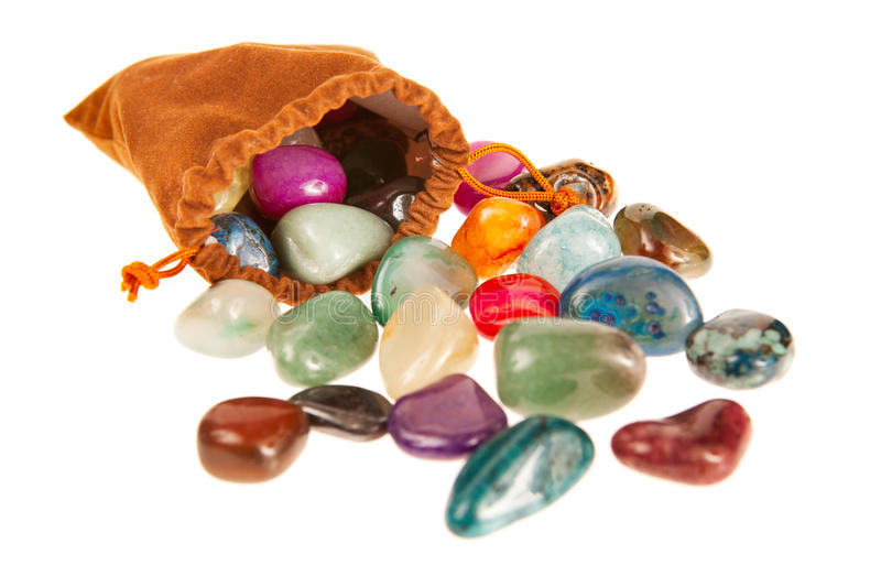 Bag of colorful stones stock image