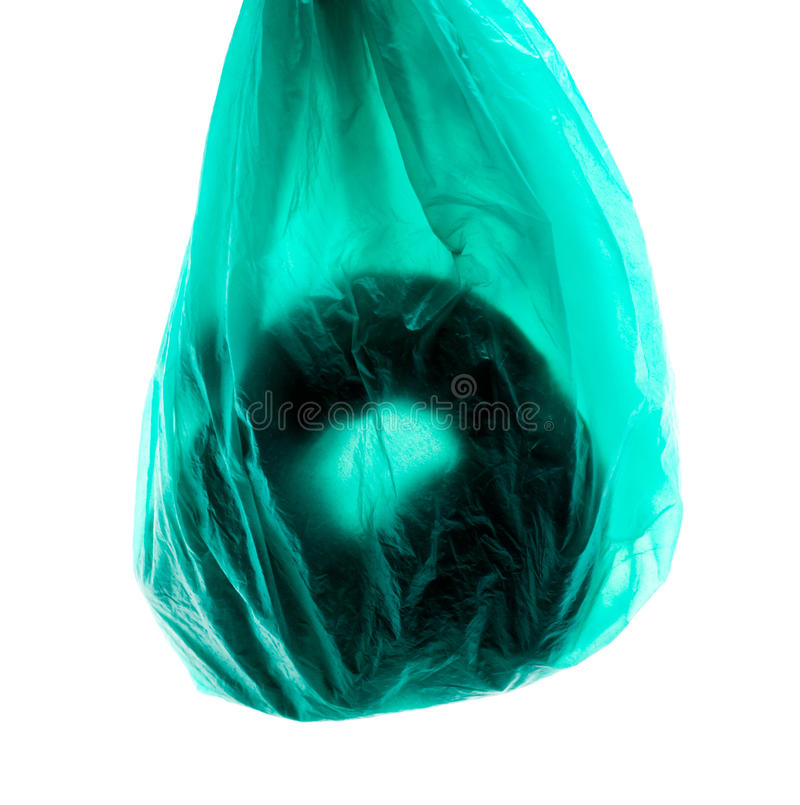 Bag of Dog poo. Plastic bag of Dog poo isolated over white royalty free stock photography