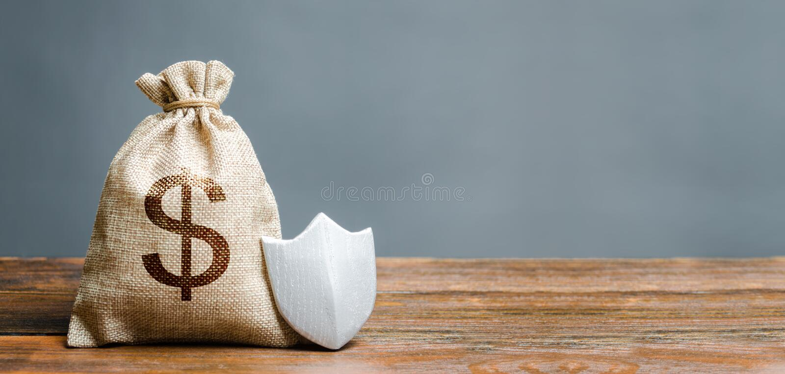 Bag with dollar symbol and protection shield. Concept of protection of money, guaranteed deposits. Client rights protection. Compensation for losses in stock photography