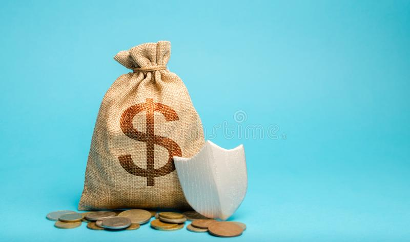 Bag with dollar symbol and protection shield. Concept security of money, guaranteed deposits. Client rights protection. stock photo