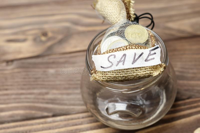 . bag with drawstring. there are coins in it. inscription save. concept of conservation and accretion. Bag with drawstring. there are coins in it. inscription stock image