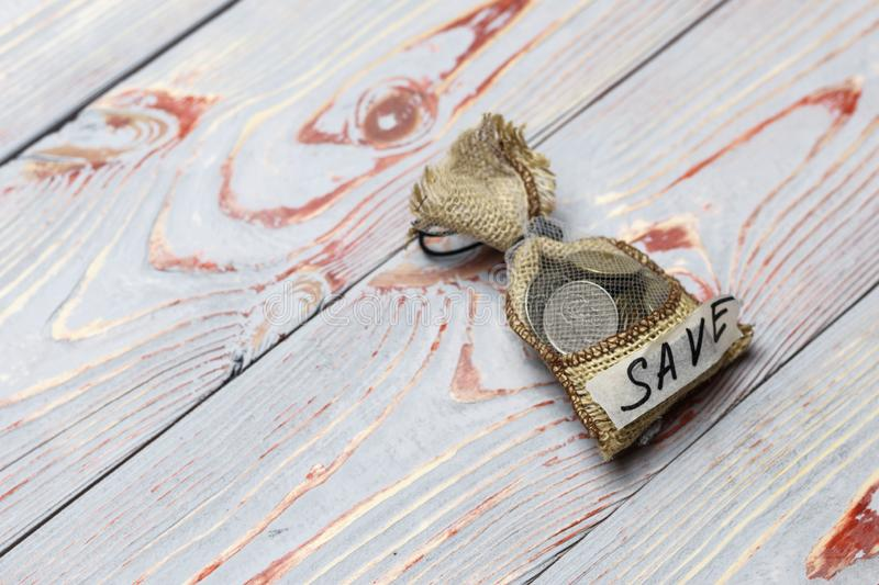 . bag with drawstring. there are coins in it. inscription save. concept of conservation and accretion. Bag with drawstring. there are coins in it. inscription royalty free stock photos