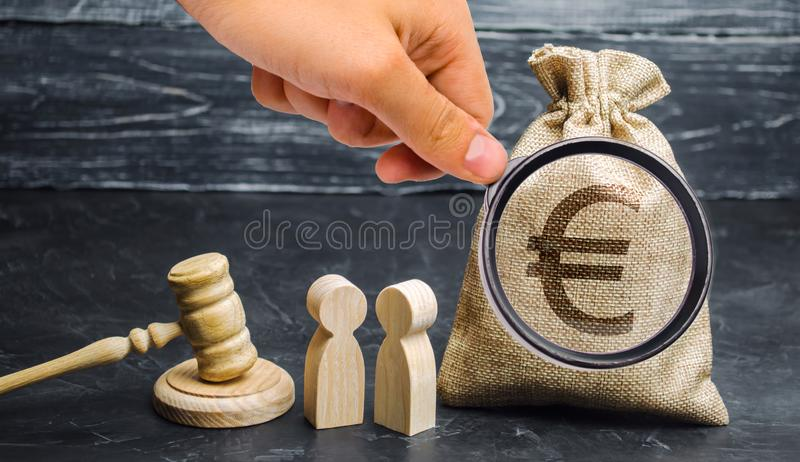 Bag with a euro sign, people and gavel. The concept of business conflict. Dispute between two businessmen. The division of royalty free stock photography