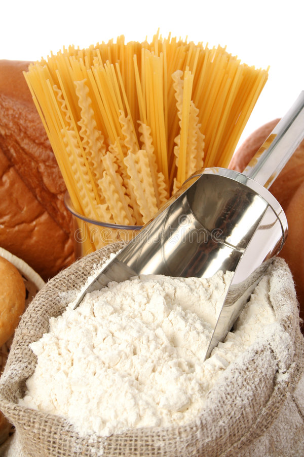 Bag with a flour and macaroni. Isolated on white stock photo