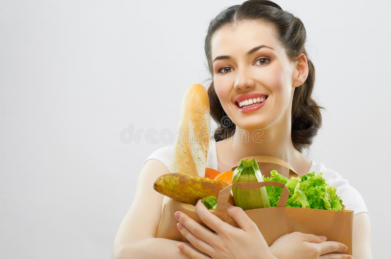 Bag of food. Girl holding a bag of food royalty free stock photo