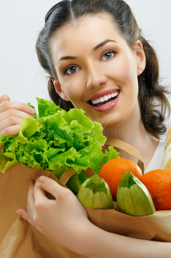 Bag of food. Girl holding a bag of food stock photos