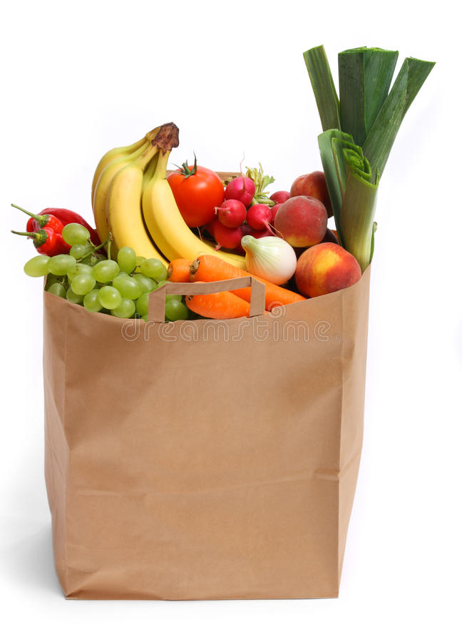 Bag full of healthy fruits and vegetables stock photography