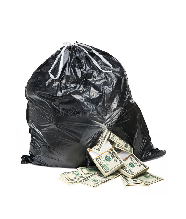 Bag full of money. Studio photography of black plastic bag with hundred dollar bills on a white background royalty free stock photography