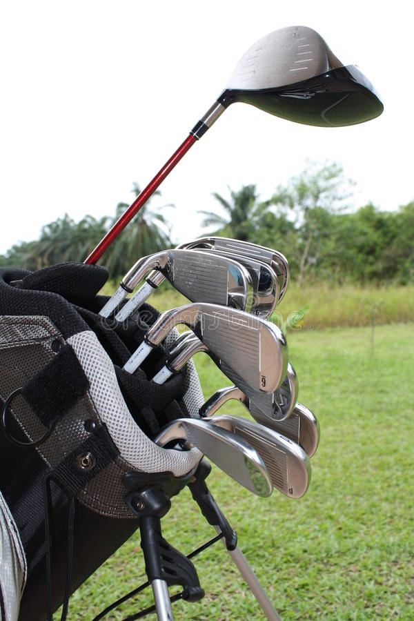 A bag of golf driver and stell irons. Golf equipment consisting of driver and iron clubs in a golf bag stock image