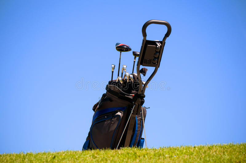 Bag for golf on lawn green. Bag for hockey-sticks for golf on a lawn green stock photo