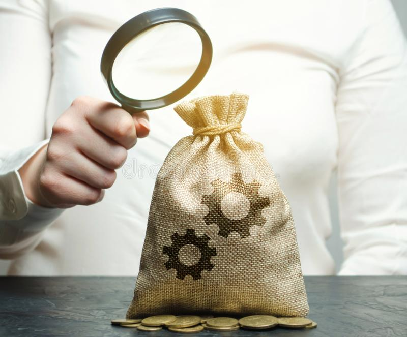 Bag with the image of gears. Investment in production. Buying patents. Intellectual property and innovative technologies. royalty free stock photo