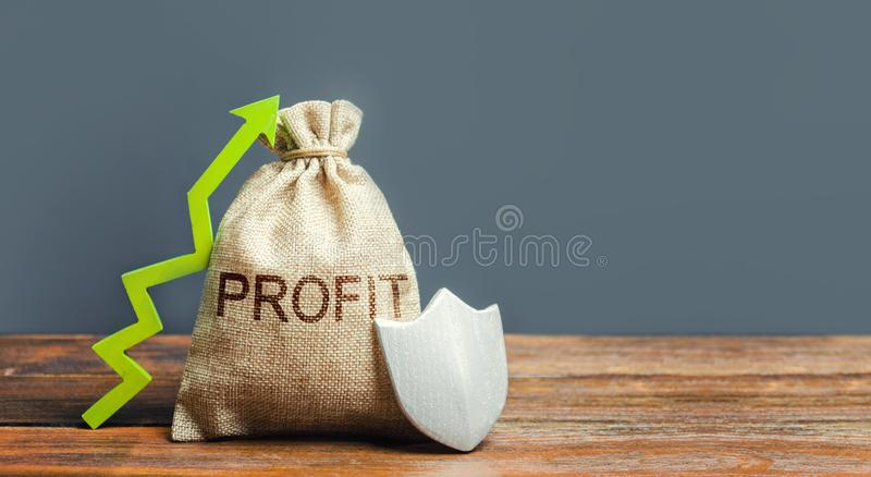 Bag with inscription Profit, a green arrow up and shield. Concept of protection of money, guaranteed deposits. Increasing. The safety of savings. Client rights royalty free stock photo
