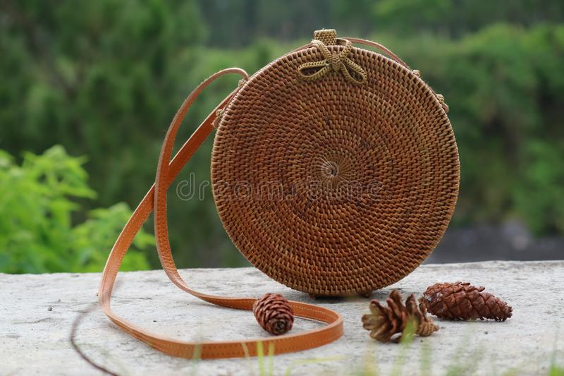 Beautiful Vintage Rattan Bag for Woman. Bag made of rattan, simple ethnic and unique. gives the impression of vintage and retro stock images