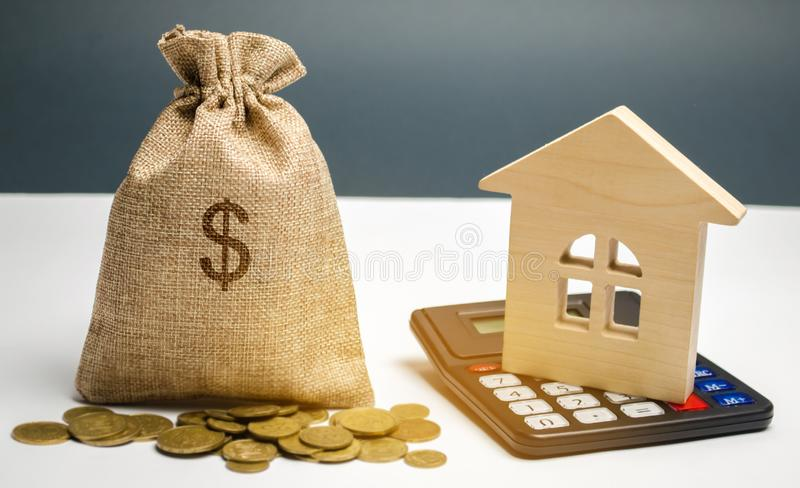 Bag with money and dollar sign and wooden houses. Financing in the country. Investing money in real estate. Saving and. Accumulation of money. Mortgage. Buying royalty free stock images