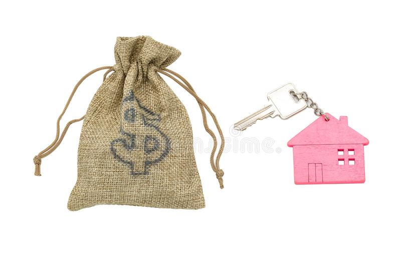Bag with money and House key, isolated on white background. Mortgage concept.  stock photo