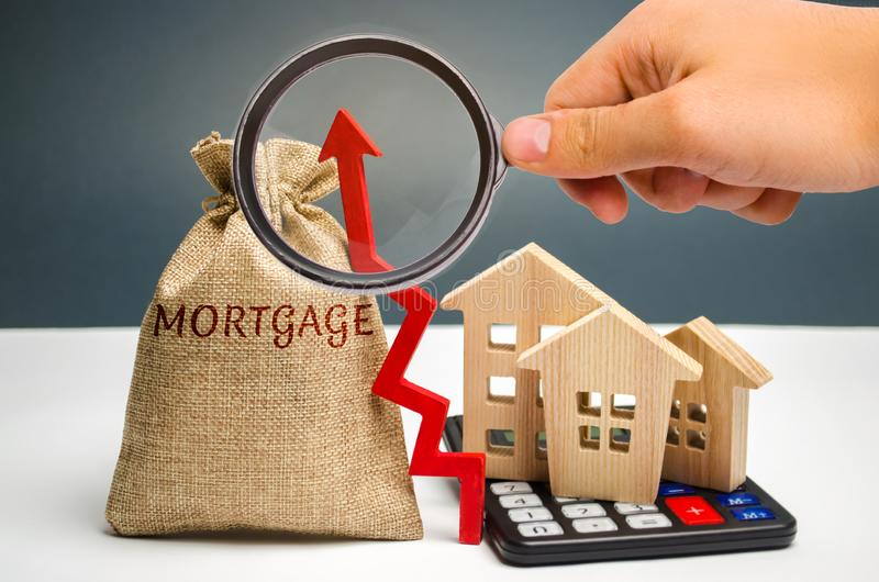 A bag with money and the inscription Mortgage and up arrow. Raising mortgage rates and tax. The increase in interest charges. Loan. For housing, apartment and stock images