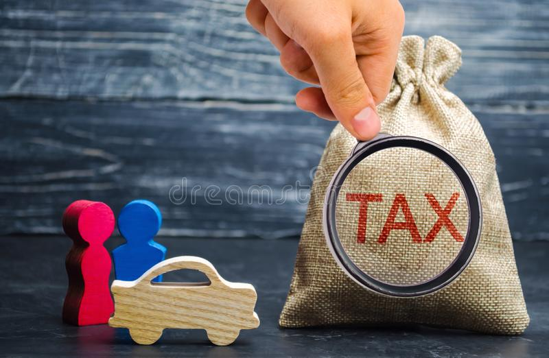A bag with money and the word Tax and a car with family. Concept the taxes payment for auto. Vehicle, road, disc tax. Is an annual. Tax that is levied as an royalty free stock photos