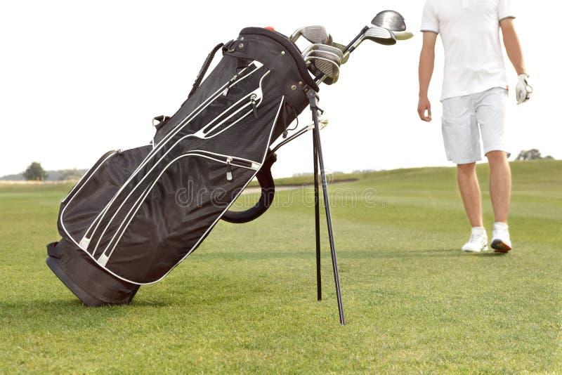 Bag with niblicks on the golf course. A bag with niblicks on the golf course stock photos