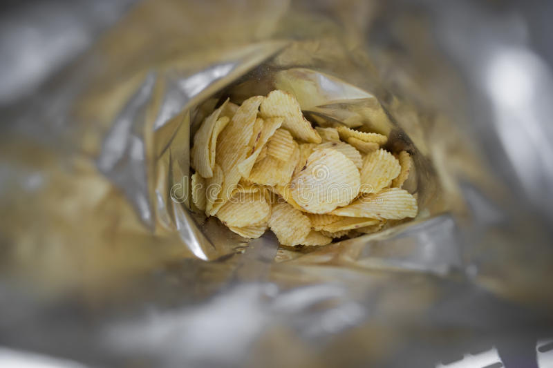 Bag of Potato Chips. Potato chips in the bag stock photo