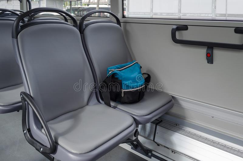 A bag on the seat in bus. Nobody royalty free stock image