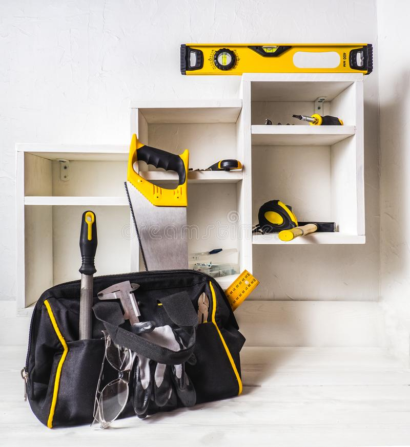 Bag with a set of tools. The installation of furniture drawers royalty free stock photo