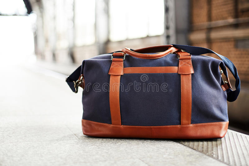 Bag waiting to start travleing in a train station royalty free stock photos