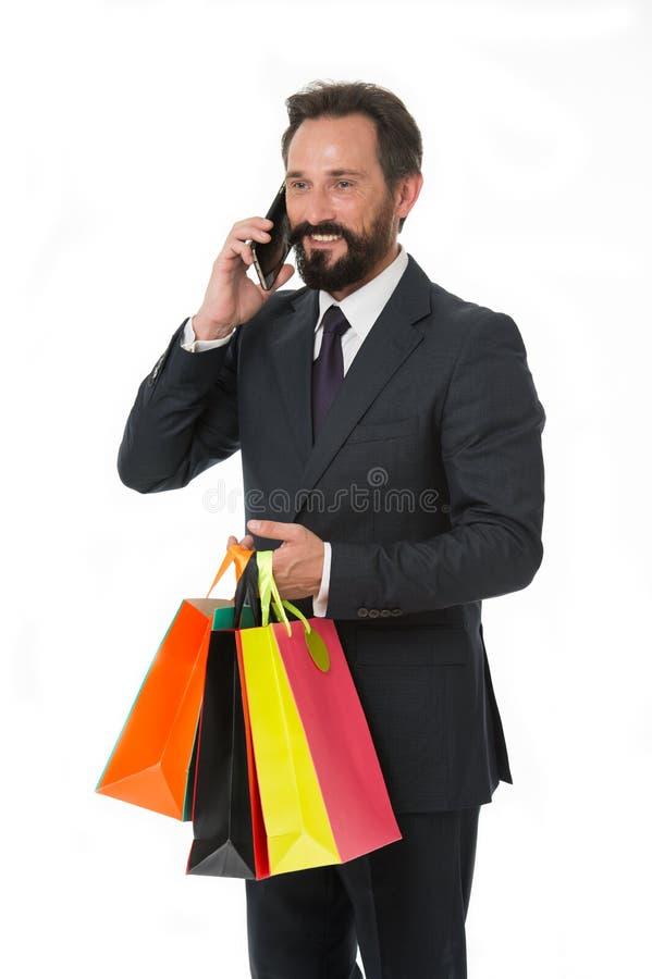 bagaże tła koncepcję czworonożne zakupy białą kobietę Szczęśliwy mężczyzna z torba na zakupy Robić zakupy nałogowiec rozmowę na t zdjęcie stock