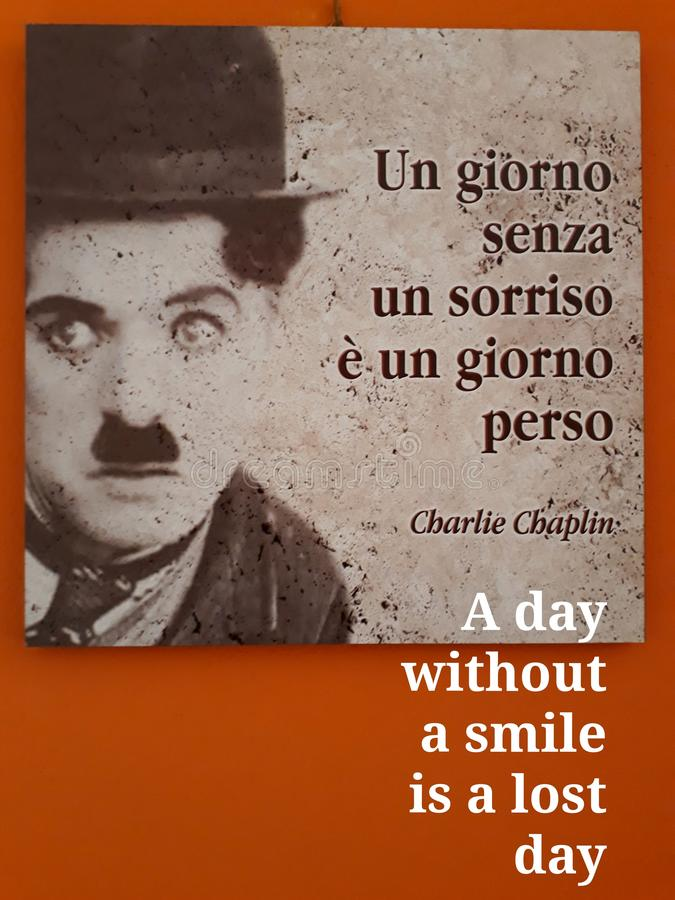 Chaplin philosophy. Bagagli, Genoa. A poster with the famous actor Charlie Chaplin philosophy. A cleaver celebrity suggesting a good lifestyle royalty free stock photography