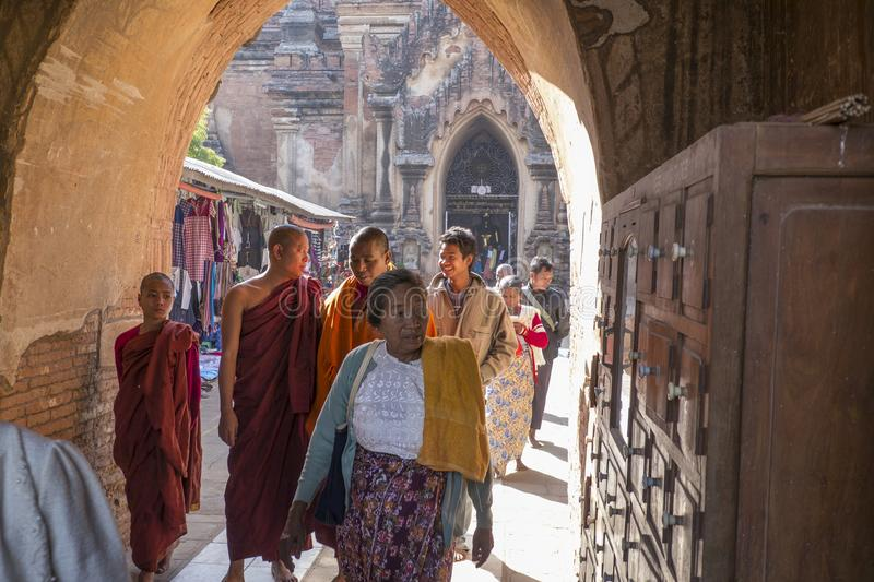 Burmese monks entering a Buddhist temple in Bagan stock images