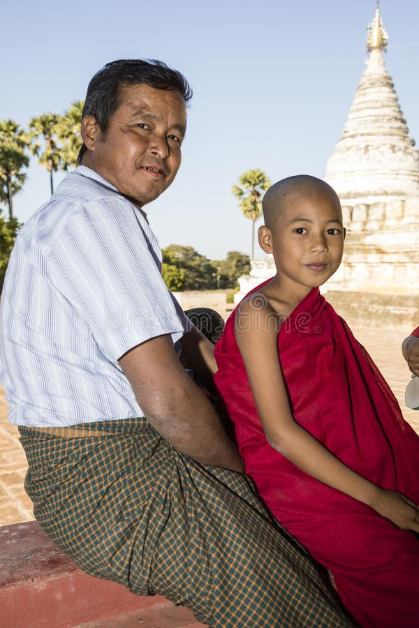 Bagan, Myanmar, December 29, 2017: Father and son as a Buddhist novice in Bagan. Bagan, Myanmar, December 29, 2017: Father and son as a Buddhist novice are royalty free stock photo