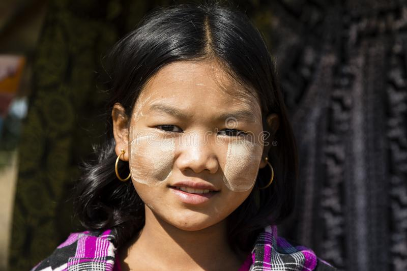 Bagan, Myanmar, December 27, 2017: Portrait of a young girl with Tanaka paste royalty free stock image