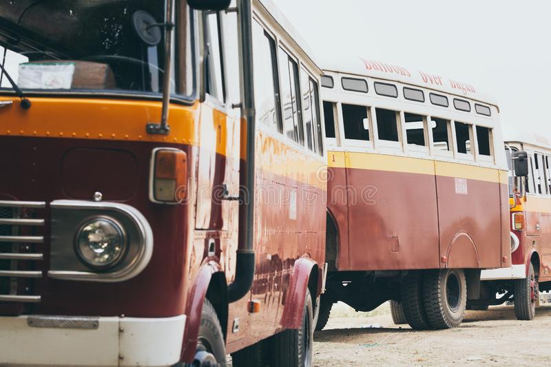 Bagan, Myanmar - March 2019: Balloons over Bagan company retro buses. Close up, old-fashioned, school, tourist, transport, burmese, delivery, traditional, asia stock photo