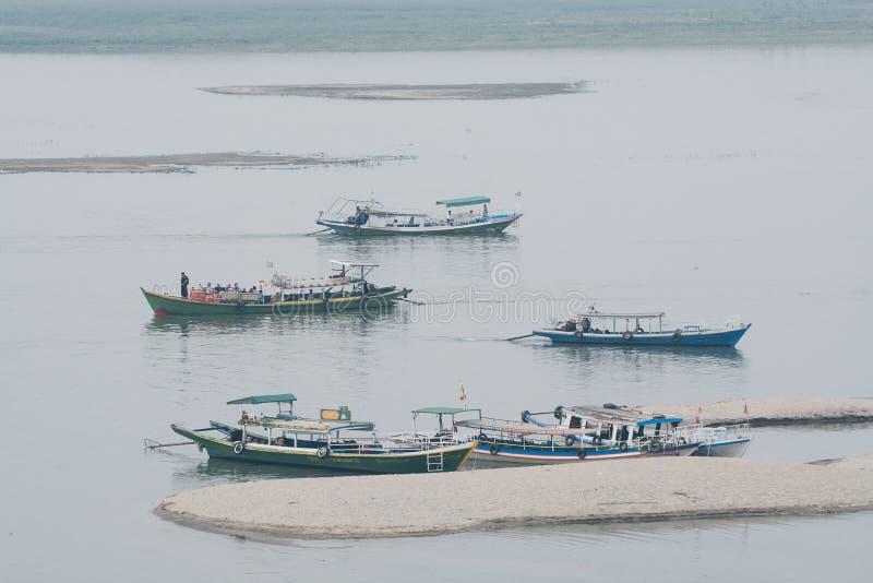 Bagan, Myanmar - March 2019: boats on Irrawaddy river. At sunrise, burma, burmese, asia, float, sail, ship, vessel, water, lake, mandalay, season, old stock image