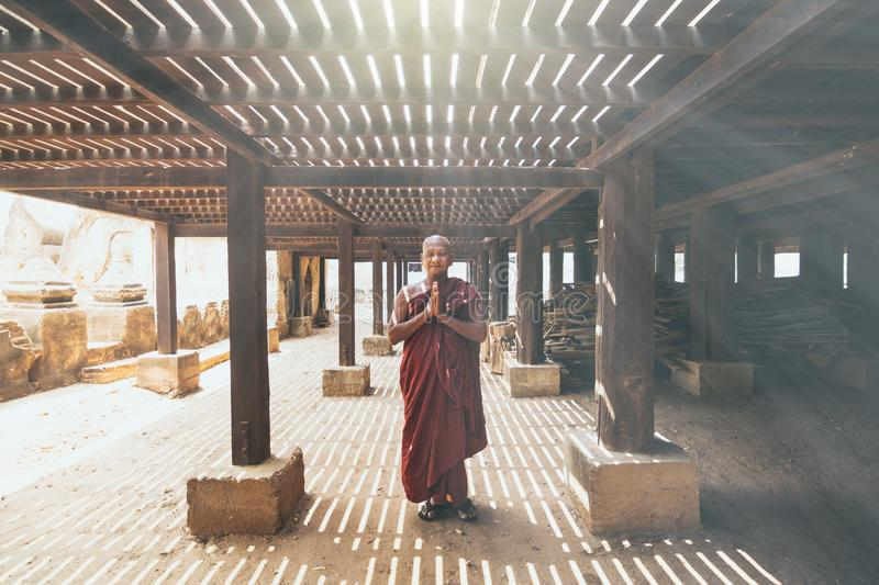 Bagan, Myanmar - March 2019: Buddhist monk praying in a monastery royalty free stock photo