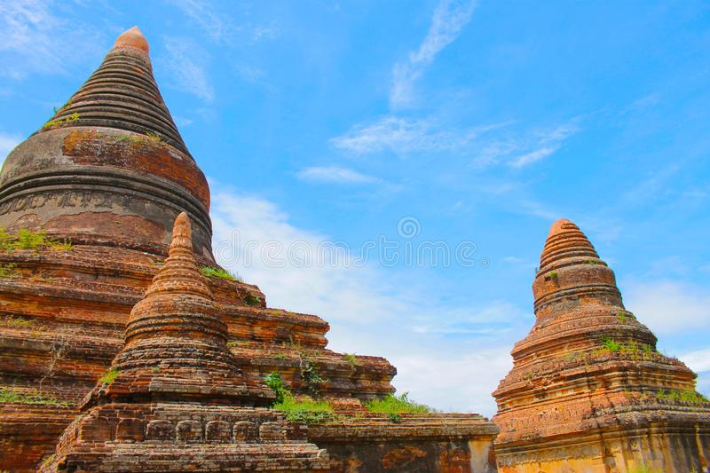 Bagan temples in the middle of the forest with a beautiful blue sky, Bagan, Myanmar Burma. stock photo
